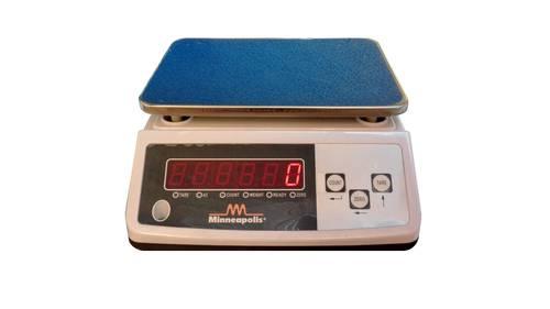 Electronic balance weighs grams